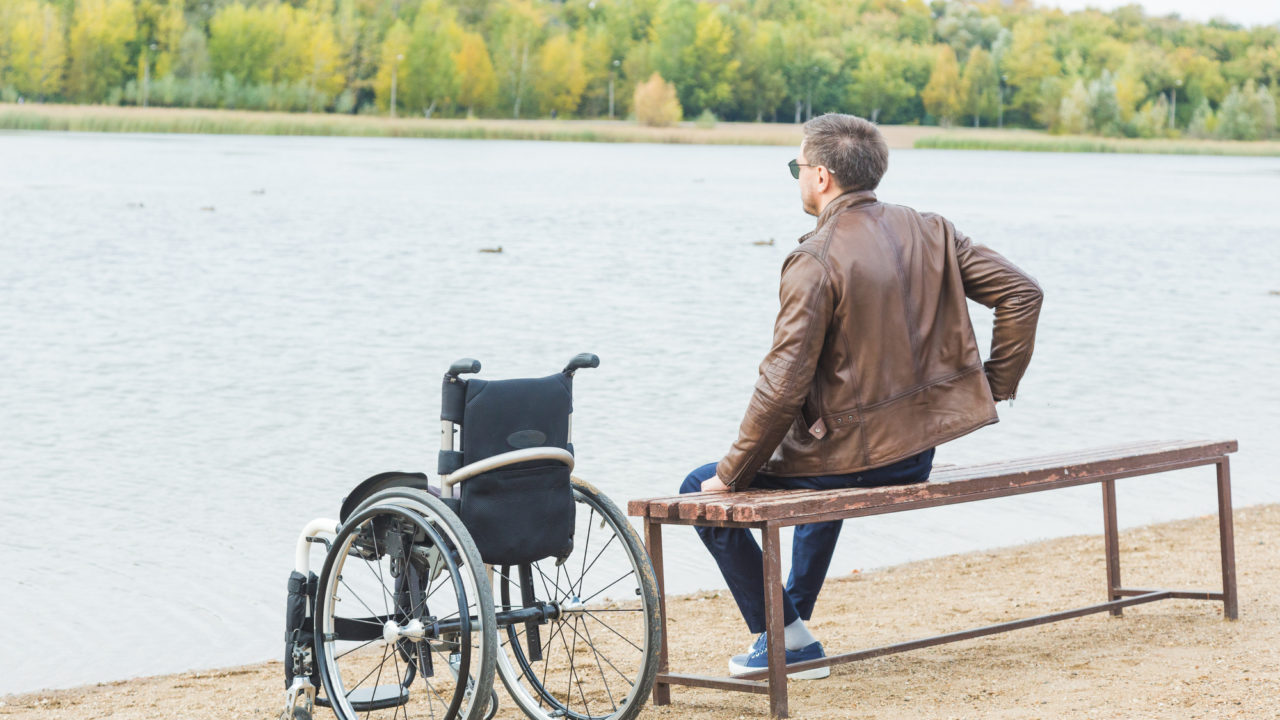 https://watsoncarroll.com/wp-content/uploads/2020/05/wheelchair-by-lake-1280x720.jpg